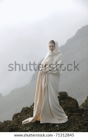 The girl shrouded in a cloud, it is high in mountains, early in the morning.
