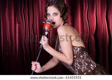The girl sings at restaurant. Style old-fashioned - stock photo