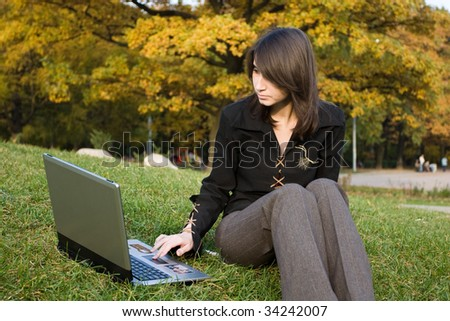 The girl sits at a computer