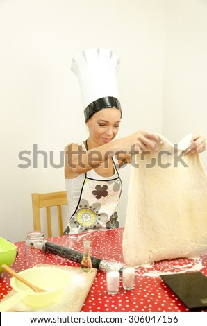 The girl stretched pizza dough - stock photo