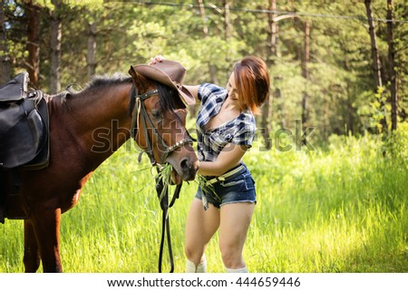 the girl the cowboy with a horse