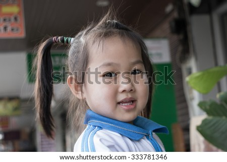 The girl tied the pigtail. in-THAILAND