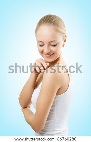 The girl touches the skin - stock photo