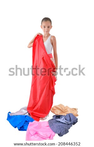 The girl tries on multi-colored fabric - stock photo