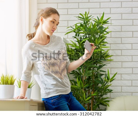 the girl uses the phone - stock photo