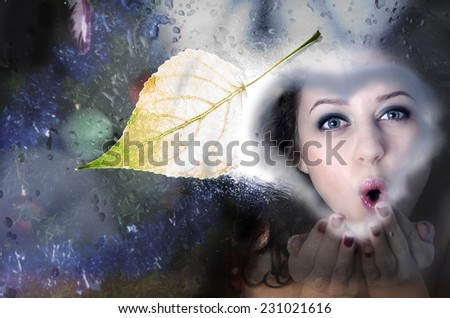 The girl waits for guests for Christmas. window.  - stock photo