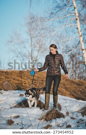 The girl walks a dog. - stock photo