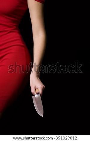 The girl who is holding knife in his hand and prepared to attack