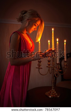 The girl with a candlestick - stock photo