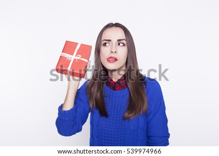 The girl with a gift in hand on white background.