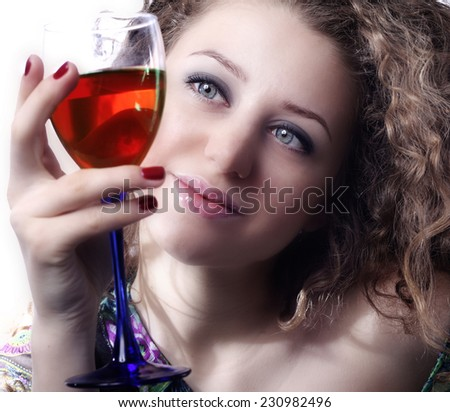 The girl with a glass of wine. - stock photo