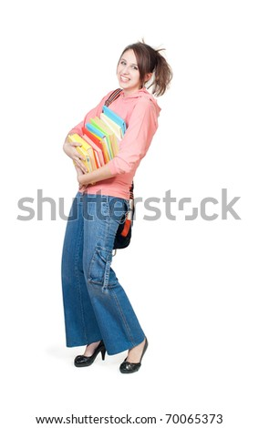 The girl with a heavy pile of books, a white background - stock photo