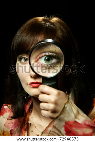 The girl with a magnifier - stock photo