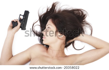 The girl with a pistol on an isolated background