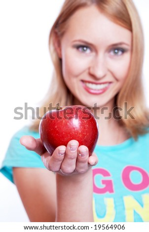 The girl with a red apple on a white background - stock photo