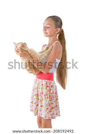 The girl with a red cat of breed Scottish-straight are photographed on the white background - stock photo