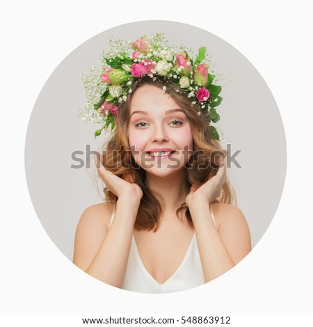 The girl with a smile in a wreath of pink and white roses. around a white background