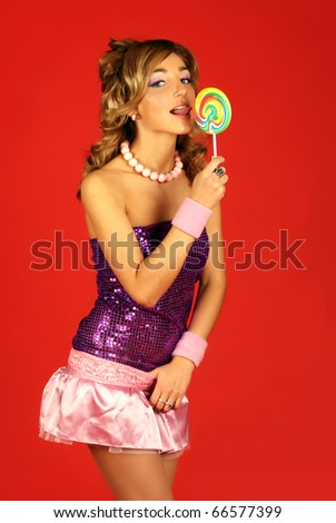 The girl with a sugar candy - stock photo
