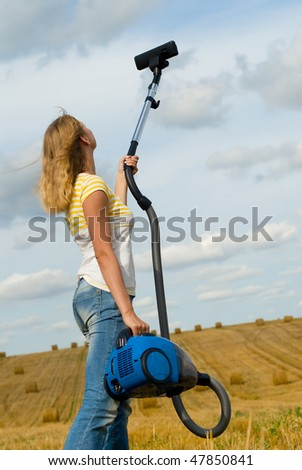 The girl with a vacuum cleaner cleans sky - stock photo