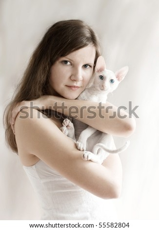 The girl with a white kitten - stock photo