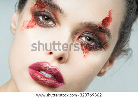 The girl with an interesting make-up of blood