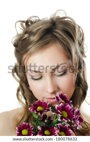 The girl with beautiful hair with chrysanthemum - stock photo