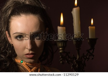 The girl with candles on a dark background