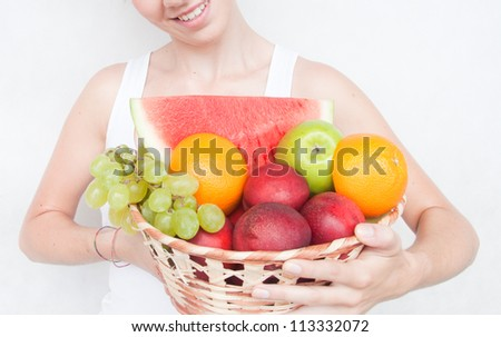 The  girl with fruit on white backround