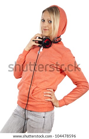 the girl with headphones stands isolated - stock photo