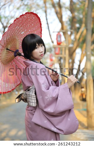 The girl with japanese yukata - stock photo