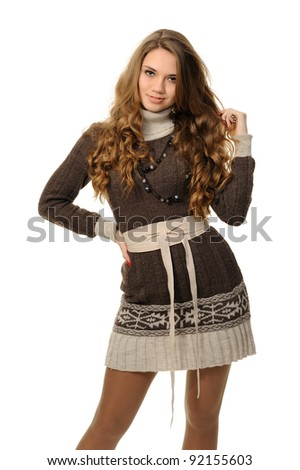 The girl with long hair in a warm dress - stock photo