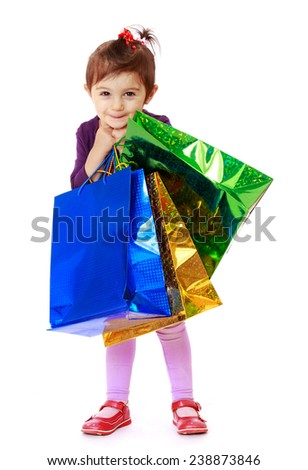 The girl with packages in hands. Isolated on white background studio photo.