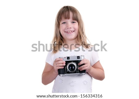 The girl with the camera in hands on a white background