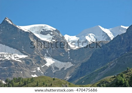 The glacier covered peaks of Piz Palu (left) and Piz Bernina (right) in Southern Switzerland above St Moritz