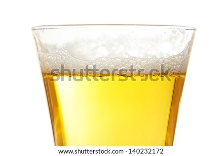 The glass of fresh light beer, closeup isolated on white