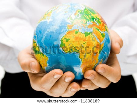 The globe in children's hands. Concept for environment conservation. - stock photo