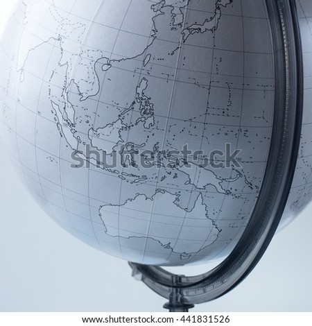 The globe on the table - stock photo