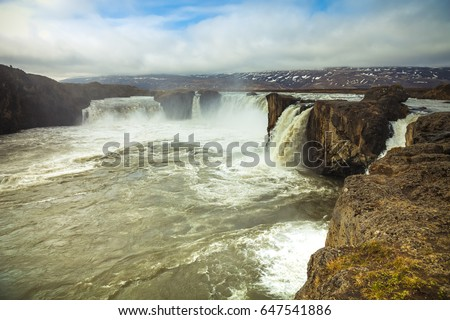 The Godafoss Waterfall - beautiful part of stony rocky desert landscape of Iceland. Toned.