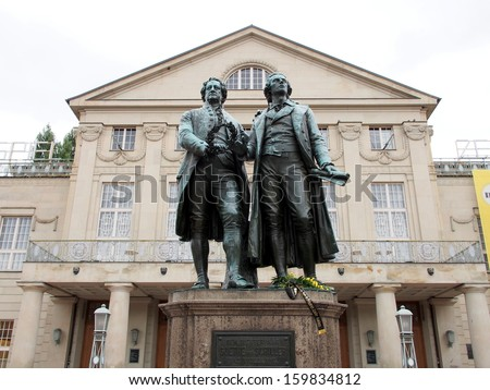 The Goethe-Schiller Monument in front of the Deutsches Nationaltheater - Weimar, Germany - stock photo
