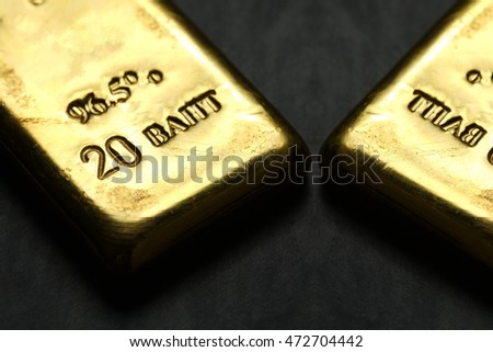 The gold bar put on the dark surface background scene represent gold and business finance concept related idea.