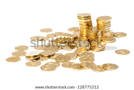 The golden coins close up background on white - stock photo
