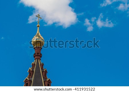 The Golden dome of the temple on blue sky background
