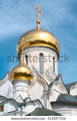 the Golden dome with the cross of the Russian Orthodox Church - stock photo