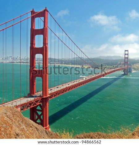 The Golden Gate Bridge in San Francisco with beautiful azure ocean in background - stock photo