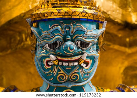 The Golden Pagoda and Yak statue at the phra keaw, bangkok,Thailand - stock photo