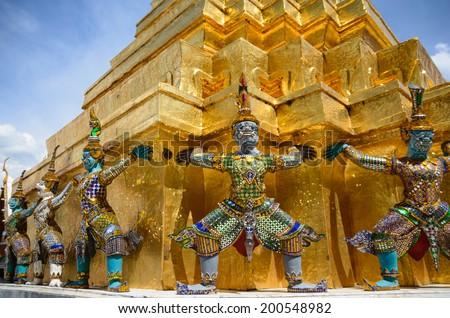 The Golden Pagoda and Yak statue at the Wat Phra Kaew , Bangkok, Thailand - stock photo