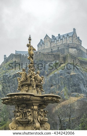 The golden Ross fountain in Princess street gardens in Edinburgh, Scotland creates a beautiful setting with the historic castle in the background. - stock photo