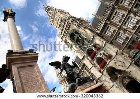 The Golden statue of Mary (Mariensaule), a Marian column on the Marienplatz in Munich, German - stock photo