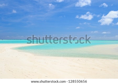 The gorgeous color of Aitutaki lagoon and his remote atolls, Cook Islands - stock photo