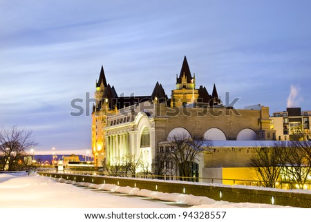The Government Conference Centre in front of the Fairmont Chateau Laurier Hotel in Ottawa Canada. - stock photo